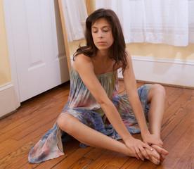 Woman in Tie Dye Dress on Wood Floor