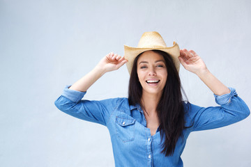 Cheerful woman laughing with cowboy hat
