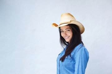 Smiling lady with cowboy hat