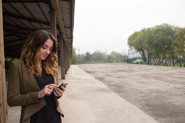 Female site manager using phone to communicate