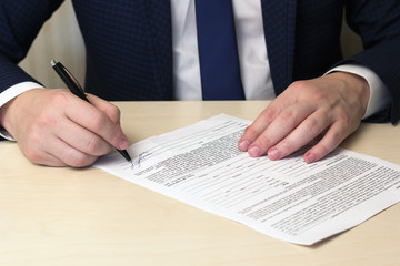 signing a contract man