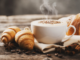 Wall Murals Cafe Hot coffee and pastries on a wooden background