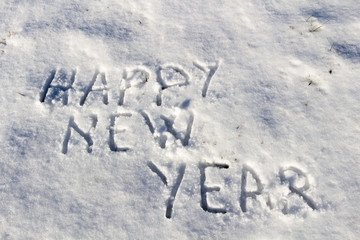 Happy New Year message on a snow field, filter applied