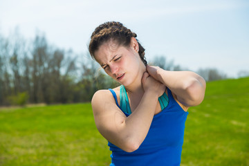 Young woman pain with neck injury .