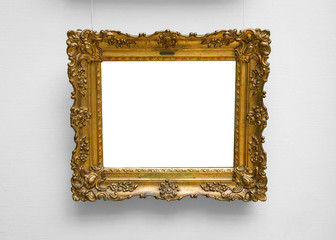 Gold empty frame on white wall