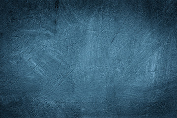 Grunge blue painted wall texture background.