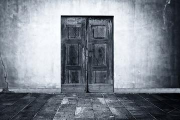 Mysterious door in the empty room as backdrop