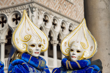 Masked duo in front of the Doges Palace during the carnival of Venice