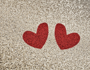 Painted two red heart on the sand