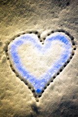 Snow with drown heart shape. Vintage filter applied.