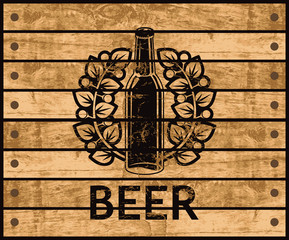 banner with the logo of a beer bottle on the background of the wooden box