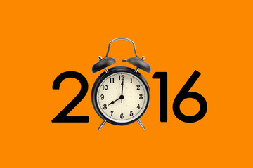 Eight o'clock on a round alarm clock and show year 2016 on orang