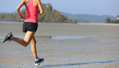 young healthy lifestyle asian woman running on beach..