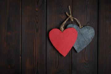 Wooden hearts on dark wood background