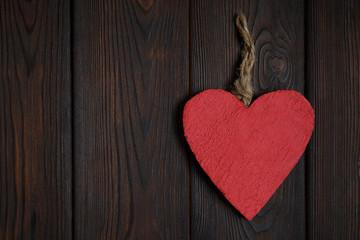 Wooden heart on dark wood background