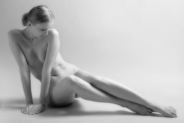 Beautiful sitting nude woman. Film grain.
