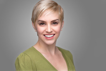 Young attractive edgy fashionable modern look young refreshing headshot short pixie hair perfect smile teeth