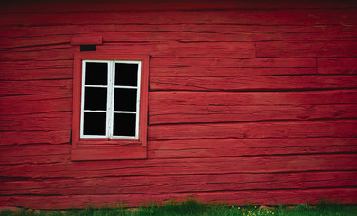 Red wooden wall with white window