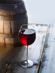 Wineglass and a old barrel