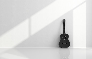 Black acoustic guitar in a white room