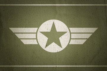 Military army star with old fabric texture background