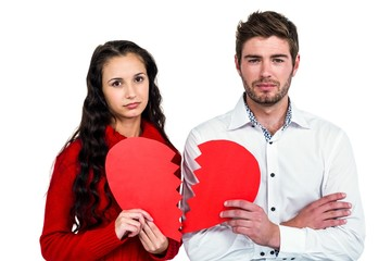 Couple holding heart halves