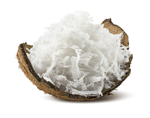Freshly grated coconut in shell isolated on white background