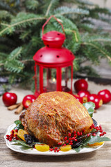 Baked pork with dried apricots on christmas table