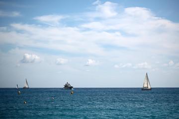Sea vessels on seascape background