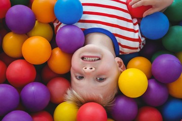 Cute smiling boy in sponge ball pool