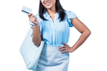 Smiling woman with a credit card in hand