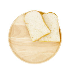 Slice of brown bread on wooden breadboard isolated white backgro