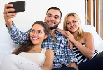 Friends doing selfie at home.