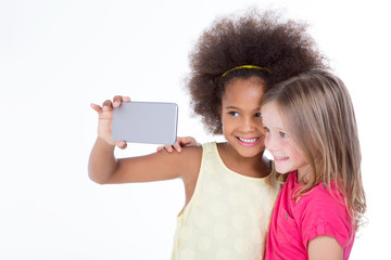 two little friends taking a selfie together