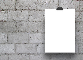 One empty paper sheet frame hanged by clip on concrete blocks wall background