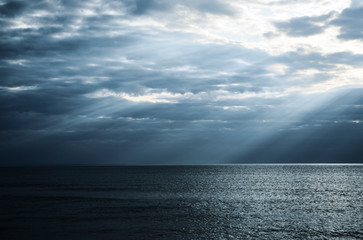 dramatic sunbeams in the sea