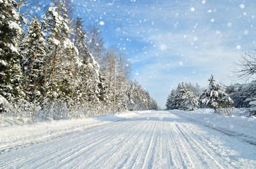 Road in a countryside in sunny winter day. Classic snow covered