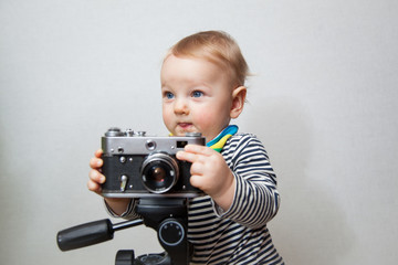 One year old baby boy with  camera