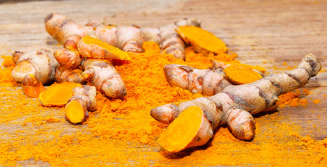 tumeric root on a white background