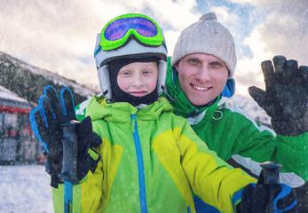 Father with son portrait on ski snow resort