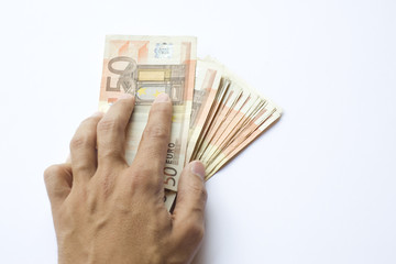 Conceptual euro paper money banknote in human or man hand