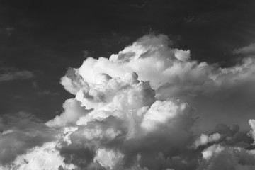 Natural landscape of large cumulus clouds in the sky. Black and white photo