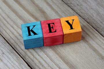 key text on colorful wooden cubes