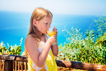 Little girl drinking traditional southern Italian lemon juice