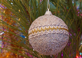 silver christmas tree ball on pine tree