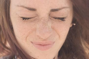 Attractive caucasian girl is grimacing outdoor
