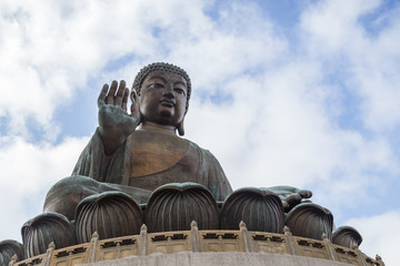 Tian Tan Buddha or Big Buddha statue in Hong Kong, China, viewed from below.