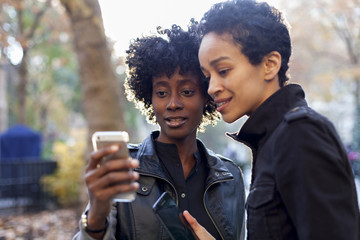 Young women checking their smart phones