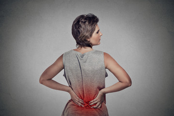 young woman with backache lower back pain colored in red