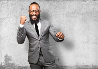 business black man winner gesture